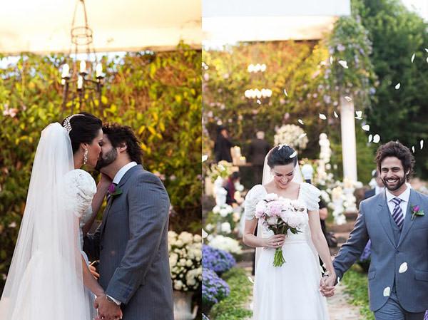beijo dos noivos chuva de petalas saida dos noivos