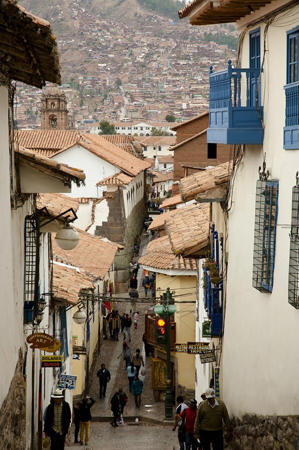 Cuzco, Peru - September 12, 2014: Pedestrian traffic on Cuesta San Blas street merging with Hatunrumiyoc street in Cuzco