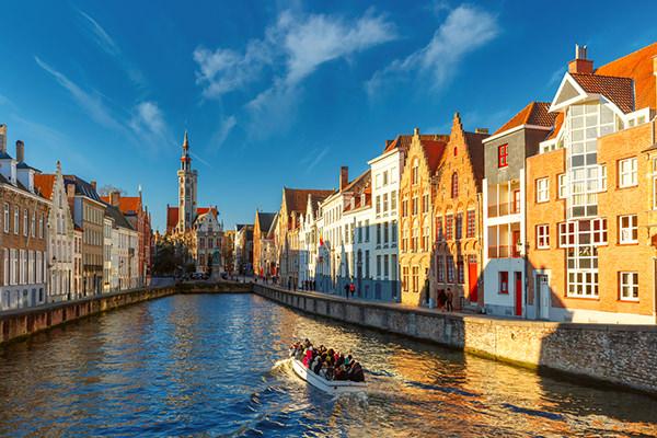 Tourist boat on canal Spiegelrei, Bruges, Belgium